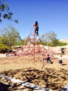 me at the top of a giant jungle gym made out of ropes