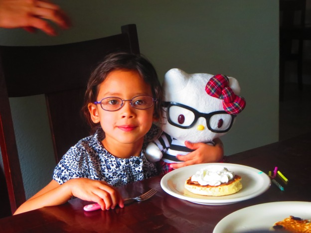 Miss Marley with ehr new Hello Kitty, both of them in glasses