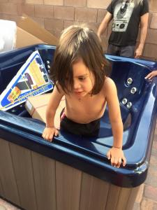 Jackson inside the empty hot tub