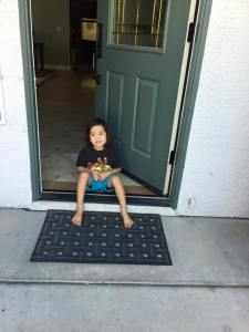 Jackson waiting at the front door for his big sister to come home from school