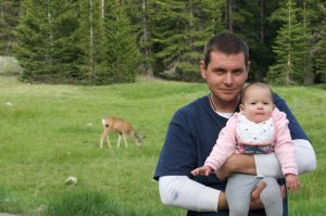 yes, that's deer in the meadow behind Daddy holding baby Marley, the meadow just a few feet from our tent.