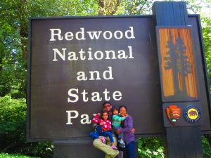 us on the California Redwoods sign