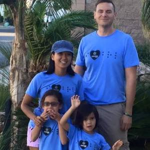 "image of our family in our, ""I love Braille,"" shirts, and the kids making silly faces of course"