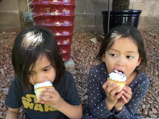 my kids eating cupcakes