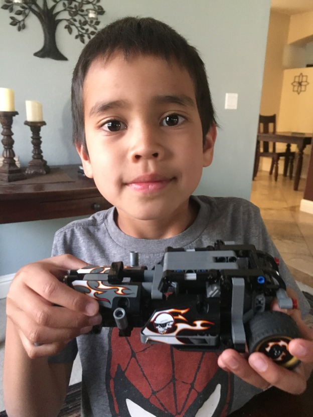future engineer holding a lego car