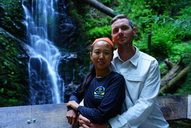 hubby and I with a waterfall behind us, This photo was taken on our 14 mile hike day in Big Basin State Park.